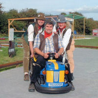 The Mangledwurzels showing that they can drive a tractor at the Animal Farm Adventure Farm in Berrow (27 Aug 2007)