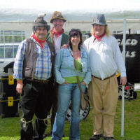 The Mangledwurzels posing with Viv from Long Ashton - longtime fan and band pin-up girl - at Camerton Village Day (19/7/8)