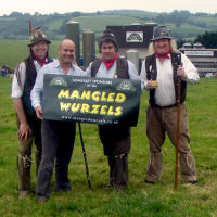 The Mangledwurzels with Rich Clothier outside Wyke Farms' main cheese factory in Bruton.