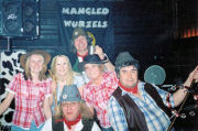 The Mangledwurzels posing with the bar staff and landlady at Barrs Court, Bristol (28 Apr 2006)