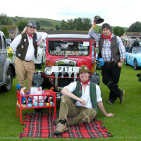 The Mangledwurzels casually hijacking Postman Pat's van at the Castle Cary Cavalcade Of Motoring (13th July 2008)