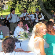 A happy bride as The Mangledwurzels perform at her wedding reception, Batcombe (3 Sept 2005)